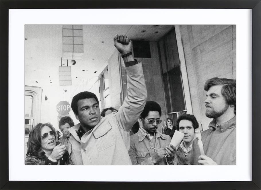 Muhammad Ali raises his Fist Framed Print